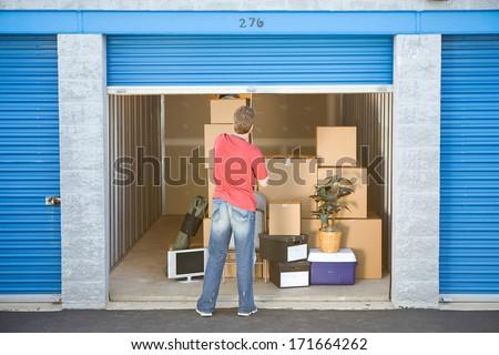 Storage: Man Finished Putting Stuff In Storage - stock photo