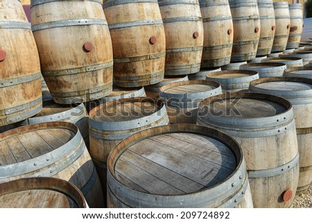 Storage of old barrels in a castle of Bordeaux vineyards