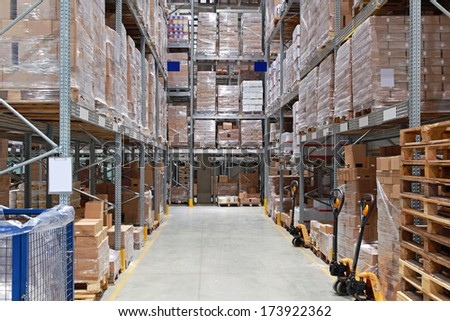 Storage shelving system in distribution warehouse - stock photo