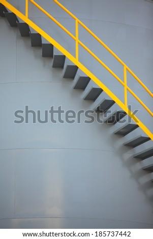 Storage tank with ladder - stock photo