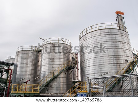 storage tanks in oil refinery - stock photo