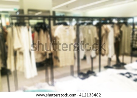 Store blur with bokeh background.Fashionable european different clothes shop - stock photo