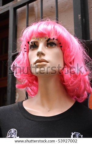 Store Front mannequin with pink wig and facial accessories - stock photo