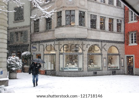 Store in old district of city in winter - stock photo