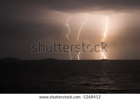 storm above the sea - stock photo