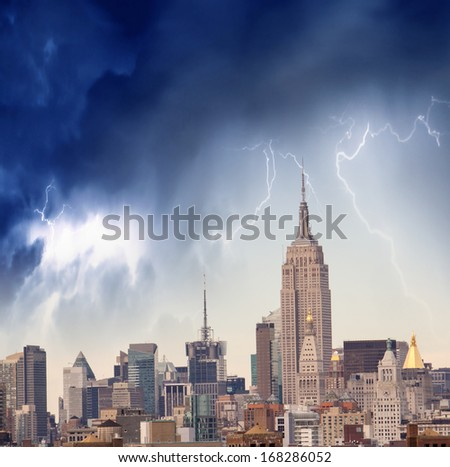 Storm approaching New York. Dramatic sky over Manhattan skyscrapers. - stock photo