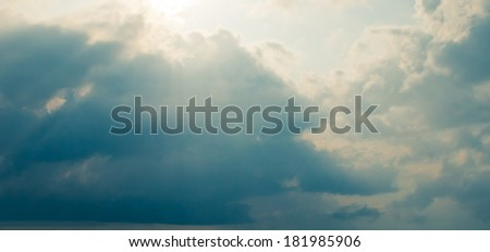 Storm clouds and sunrays. Heavenly light. Hope in hearts. - stock photo