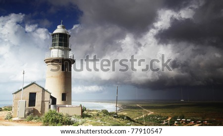 Storm clouds approaching Vlamingh Lighthouse in Exmouth, Western Australia. - stock photo
