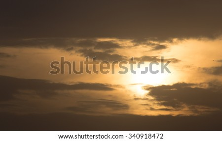 storm clouds at sunset as background