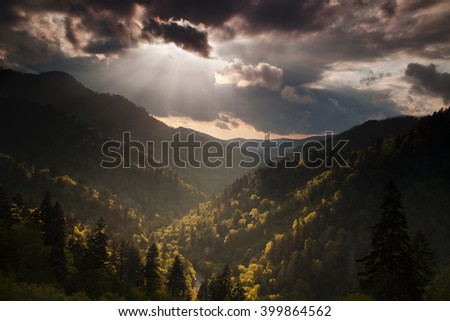 Storm clouds clearing over the Morton Overlook in the Great Smoky Mountains National Park at sunset. - stock photo