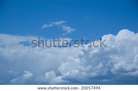 Storm clouds gather on a blue sky sunny day - stock photo