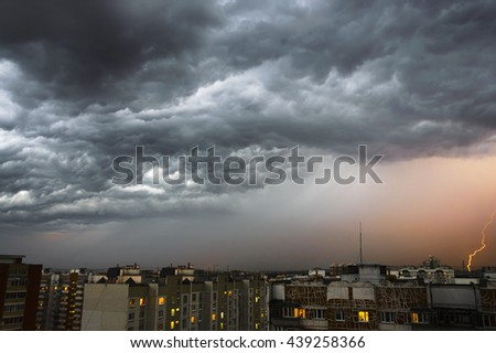 Storm clouds, heavy rain. Thunderstorm and lightning over the city. Night Scene. - stock photo