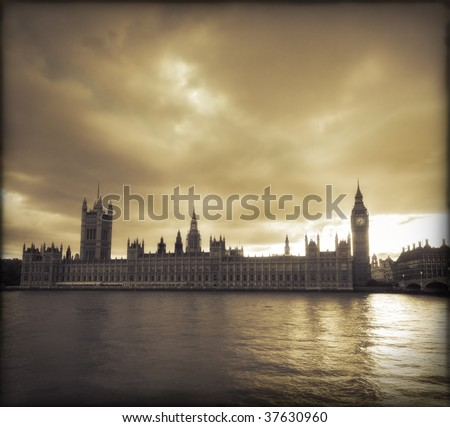 Storm clouds over Big Ben and the Houses of Parliament in London - stock photo