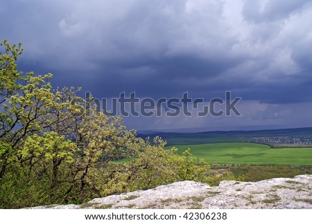 storm clouds over fields - stock photo