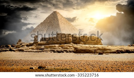 Storm clouds over pyramid of Cheops in Giza - stock photo