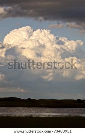 Storm clouds over Saskatchewan slough - stock photo