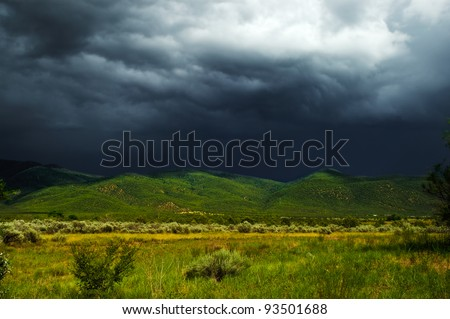 Storm clouds over Taos, New Mexico - landscape - stock photo