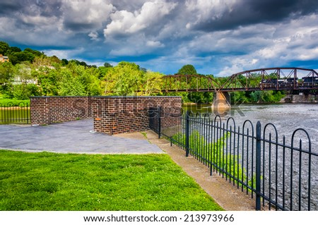 Storm clouds over the Delaware River and a train bridge in Easton, Pennsylvania. - stock photo