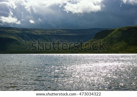 Storm clouds over the  lake Seydyavr surrounded by mountains
