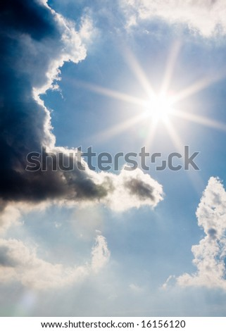 storm clouds parting to reveal the sun - stock photo