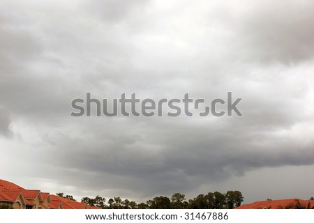 Storm clouds rolling in to fill the florida sky with buildings along the bottom.
