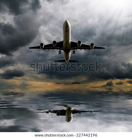 Storm clouds with aircraft - stock photo