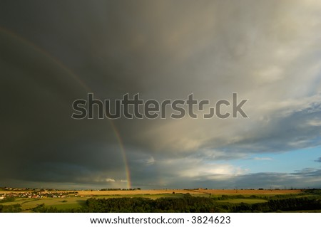 Storm Clouds with Rainbow