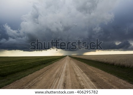 Storm down a dirt path.