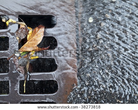 Storm drain on the streets of New York City - stock photo