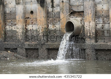 Storm Drain Outflow (stormwater, water, drainage) - stock photo