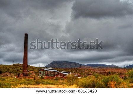 Storm forming over a deserted mine - stock photo