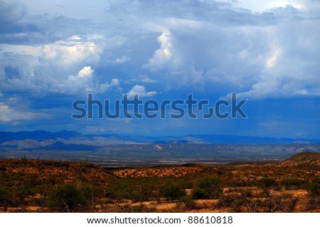 Storm forming over the southwest desert mountains - stock photo