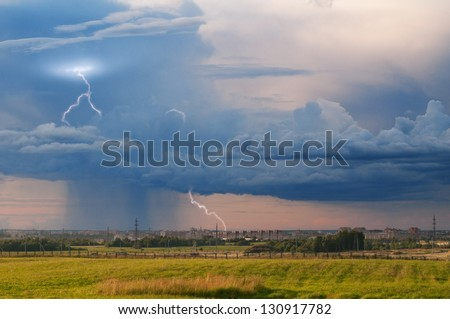 Storm heavy rain over a field on the suburb of the city of Vologda. - stock photo