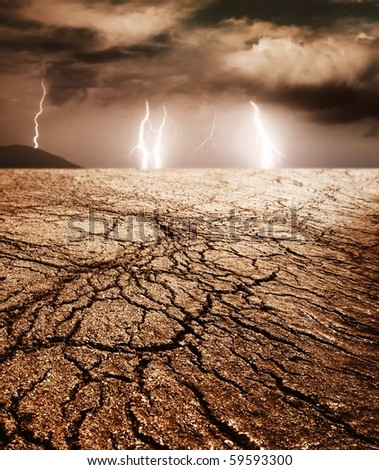 Storm in desert - stock photo