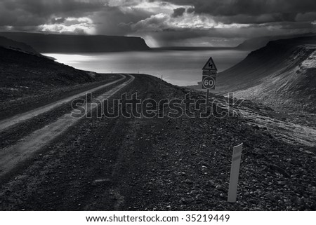 Storm in fjord - black and white. West Fjords, Iceland - stock photo