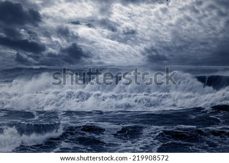 Storm in the portuguese coast. Enhanced sky. Toned blue. - stock photo
