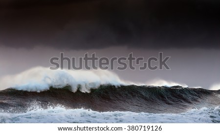 storm in the sea with big waves and dark sky - stock photo