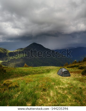 Storm is coming over the campsite - stock photo