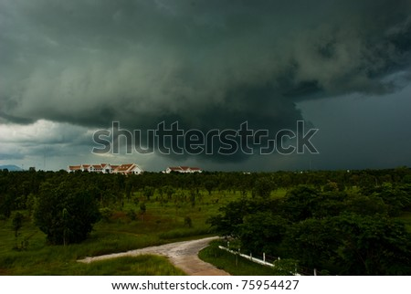 Storm is forming over the Government Center Kamphaeng Phet, Thailand. - stock photo
