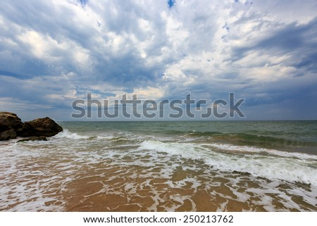Storm on sea, dark clouds in sky - stock photo