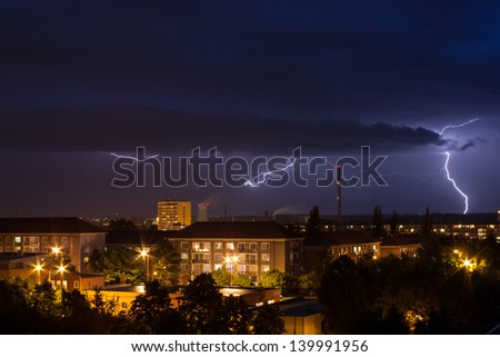 Storm over city in Czech Republic - stock photo