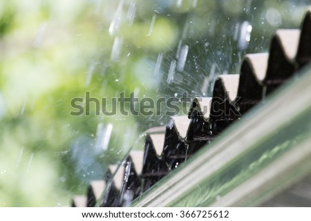 storm rain on the roof of the house - stock photo
