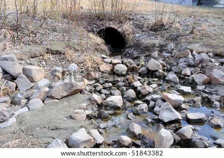 Storm Water Drain carrying Spring Runoff - stock photo