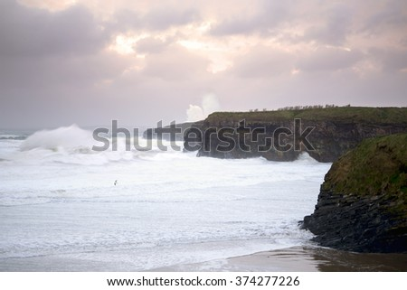 storm waves and cliffs on the wild atlantic way in Ballybunion county Kerry Ireland - stock photo