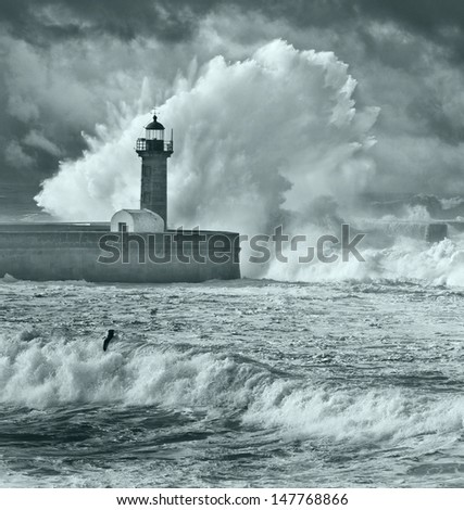 Storm waves over the Lighthouse, Portugal - blue filter - stock photo