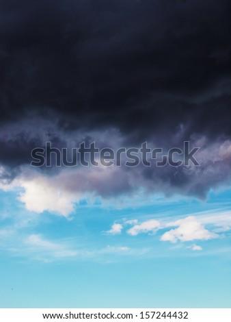 Stormy blue sky with dark cloud - stock photo