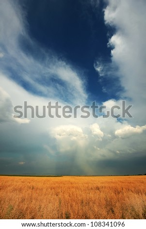 Stormy clouds over a farm field