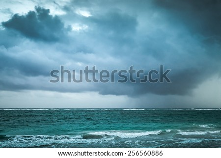 Stormy clouds over Atlantic ocean. Landscape with dramatic stormy sky, Dominican republic. Punta Cana. Blue toned photo with contrast filter effect - stock photo