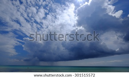 stormy clouds over paradise waters - stock photo