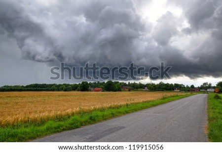 Stormy clouds over Swedish village